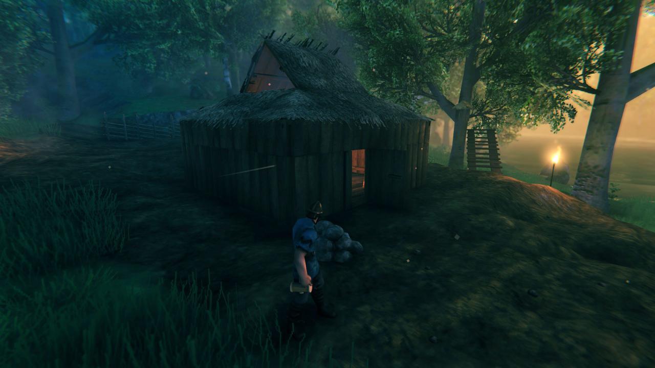 Casa de inicio de Valheim con un pozo de fuego que no lo sofoca